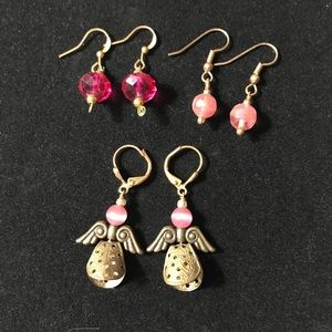 3 sets of pink earrings with angels
